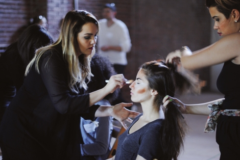 Makeup and hair artist learn the skill of multitasking.