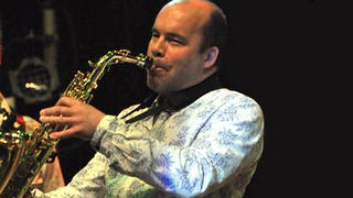 Composer David Wise playing the Saxophone